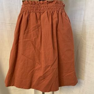 Rust mini skirt.
